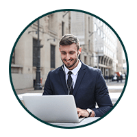 business guy working remotely on street